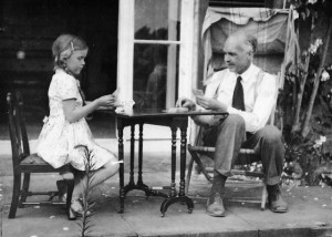 Patience Thompson playing cards with her Father, Sir Lawrence Bragg